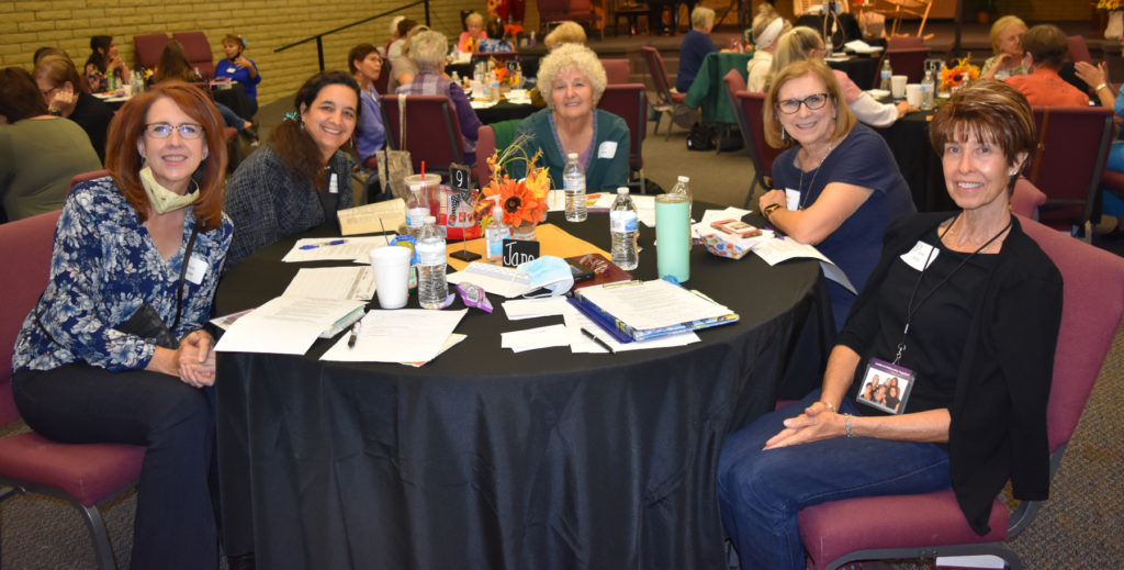 LIFT event five smiling women at a conference table