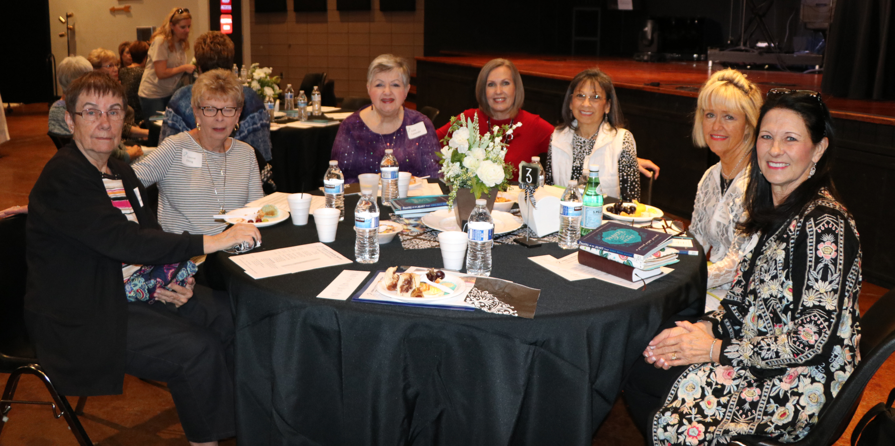 LIFT event - seven smiling women around a conference table