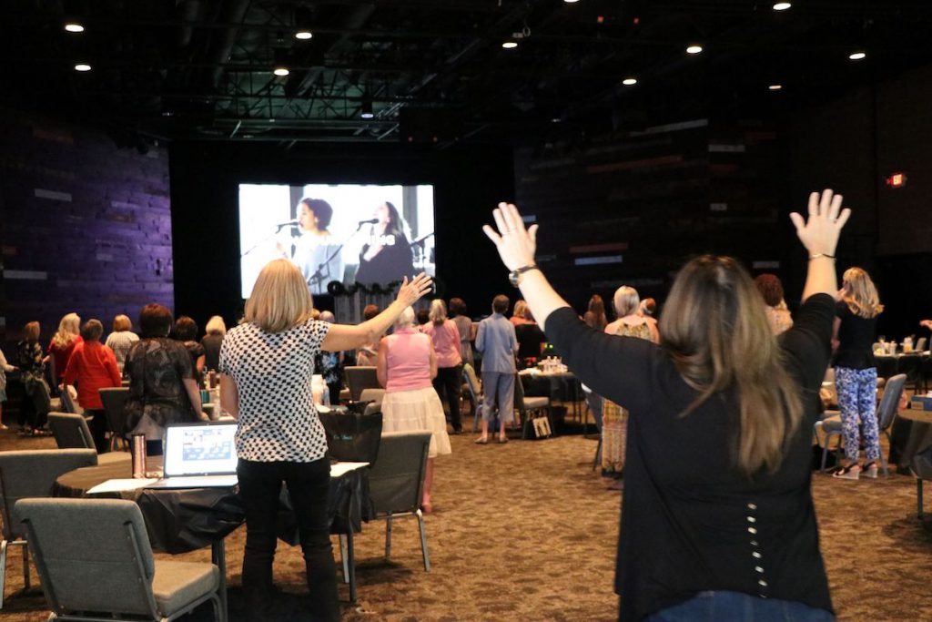 group of women worshiping